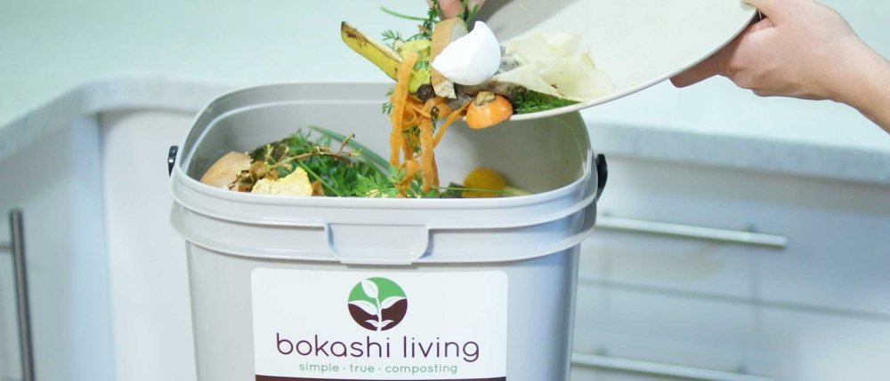 Adding food waste to bokashi composter